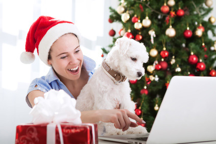Woman and white puppy dog shopping online for Christmas